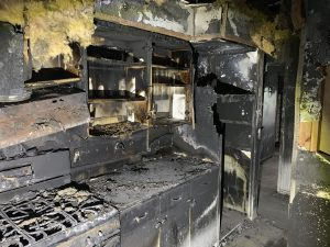 Detail of stove area in kitchen destroyed by fire.