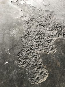 "fire damage to concrete (this is called ""spalling"". It happens when intense heat causes the surface of concrete to explode)"
